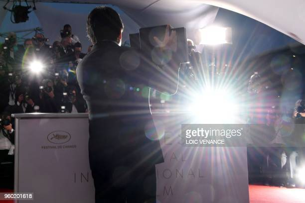 Japanese director Hirokazu KoreEda poses with his trophy on May 19 2018 during a photocall after he won the Palme d'Or for the film Shoplifters at...