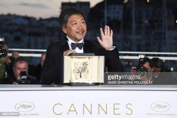 Japanese director Hirokazu KoreEda poses with the trophy on May 19 2018 during a photocall after he won the Palme d'Or for the film Shoplifters at...