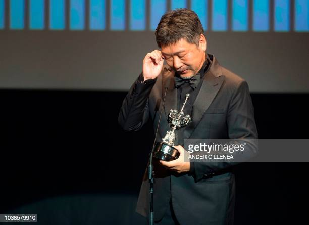 Japanese director Hirokazu KoreEda reacts crying after receiving the Donostia Award in recognition of his prestigious film career during the 66th San...