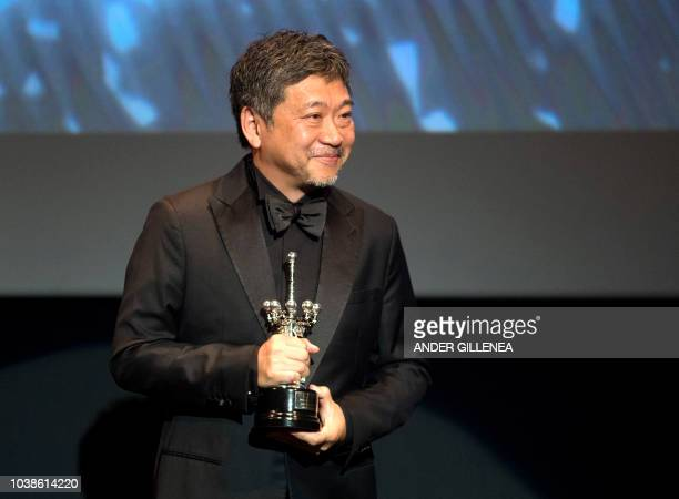 Japanese director Hirokazu KoreEda smiles after receiving the Donostia Award in recognition of his prestigious film career during the 66th San...
