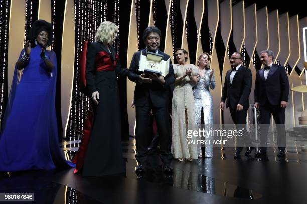 Japanese director Hirokazu KoreEda sposes with Australian actress and President of the Jury Cate Blanchett after he was awarded with the Palme d'Or...
