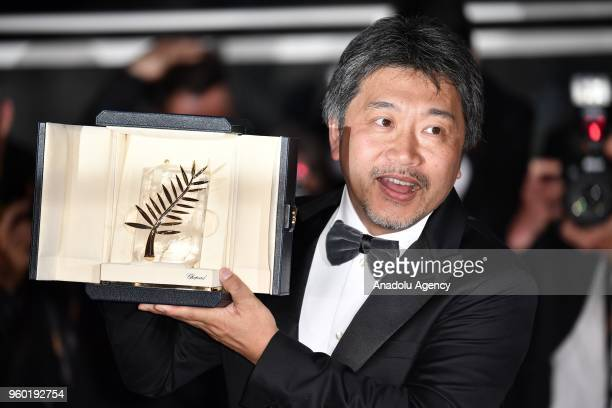 Japanese director Hirozaku KoreEda poses during the Award Winners photocall after he won the Palme d'Or award for 'Shoplifters' at the 71st Cannes...