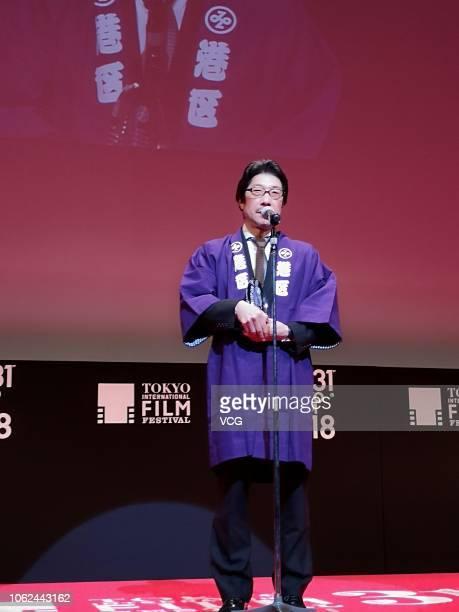 Japanese director Junji Sakamoto attends the closing ceremony of the 31st Tokyo International Film Festival on November 2 2018 in Tokyo Japan