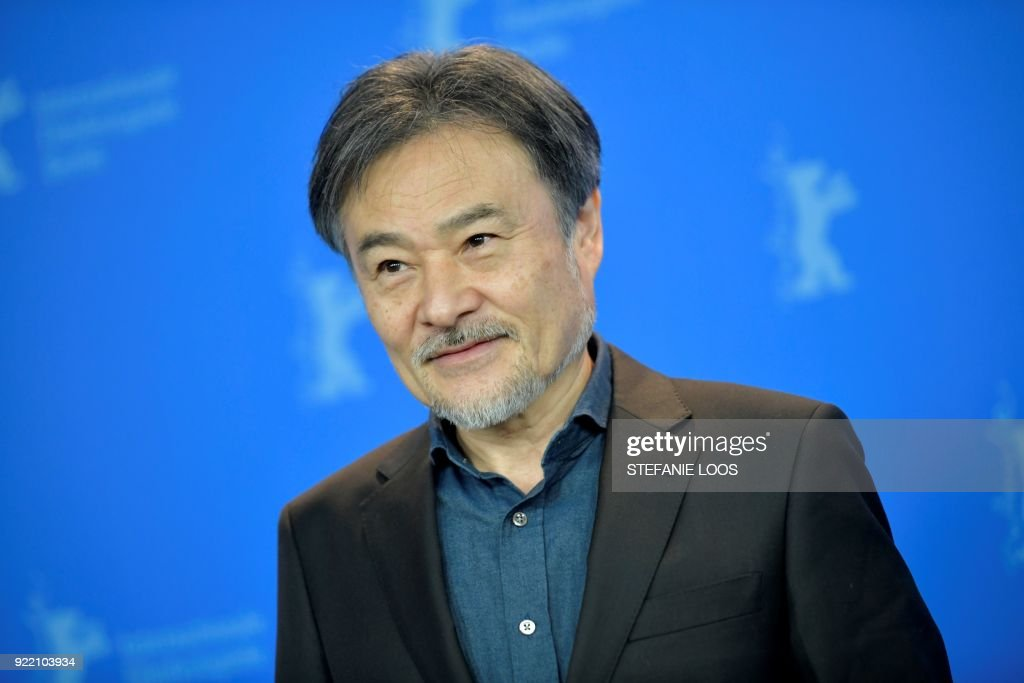 Japanese director Kiyoshi Kurosawa poses during a photo call for the film 'Foreboding' (Yocho) presented in the 'Panorama' category during the 68th edition of the Berlinale film festival in Berlin on February 21, 2018. / AFP PHOTO / Stefanie LOOS