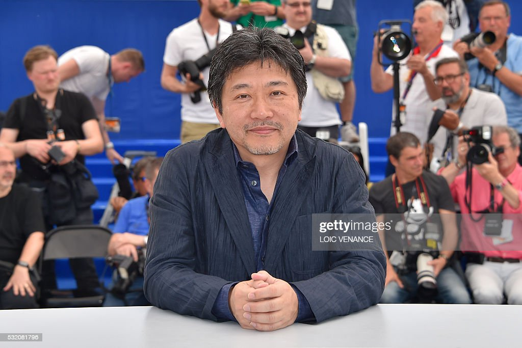 Japanese director Kore-Eda Hirokazu poses on May 18, 2016 during a photocall for the film 'After the Storm (Umi Yorimo Mada Fukaku)' at the 69th Cannes Film Festival in Cannes, southern France. / AFP / LOIC