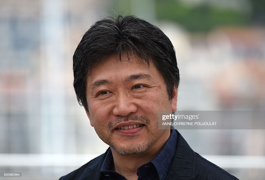 Japanese director Kore-Eda Hirokazu poses on May 18, 2016 during a photocall for the film 'After the Storm (Umi Yorimo Mada Fukaku)' at the 69th Cannes Film Festival in Cannes, southern France. / AFP / ANNE