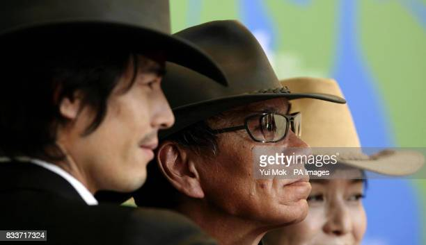 Japanese director Miike Takashi with actors Ito Hideaki and Momoi Kaori during a photocall for the film 'Sukiyaki Western Django' at the Venice Film...