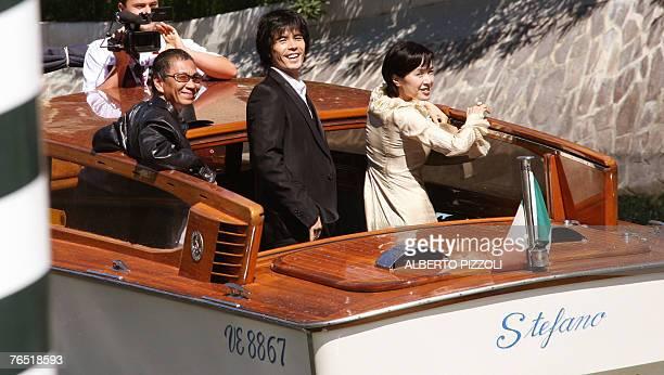 Japanese director Takashi Miike and Japanese actors Kaori Momoi and Ito Hideaki leaves after a photocall of Sukiyaki Western Django during the 64th...
