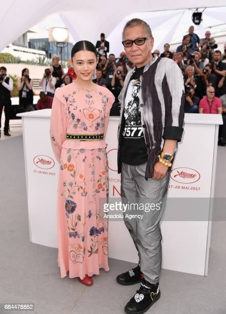 Japanese director Takashi Miike and Japanese actress Hanna Sugisaki pose during a photocall for the film Mugen No Junin' out of competition at the...