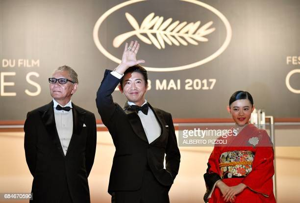 TOPSHOT Japanese director Takashi Miike Japanese actor Takuya Kimura and Japanese actress Hana Sugisaki pose as they arrive on May 18 2017 for the...