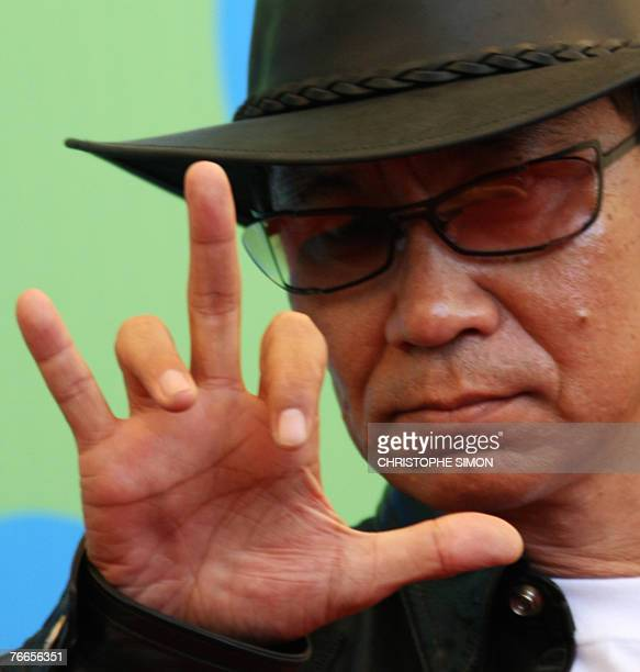 Japanese director Takashi Miike poses during a photocall of Sukiyaki Western Django during the 64th Venice International Film Festival at Venice Lido...