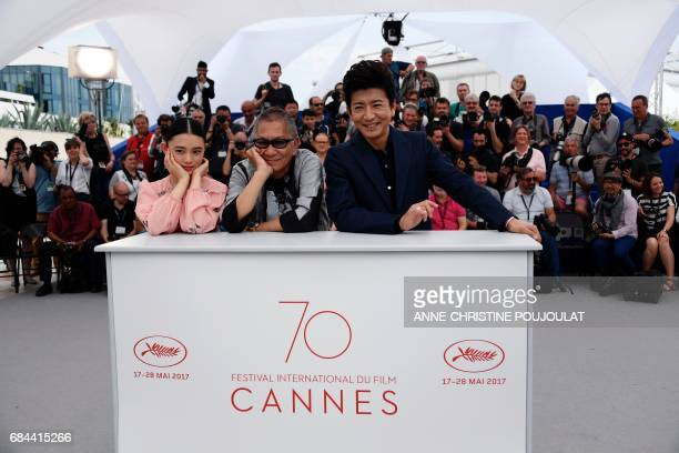 Japanese director Takashi Miike poses on May 18 2017 with Japanese actress Hana Sugisaki and Japanese actor Takuya Kimura during a photocall for the...