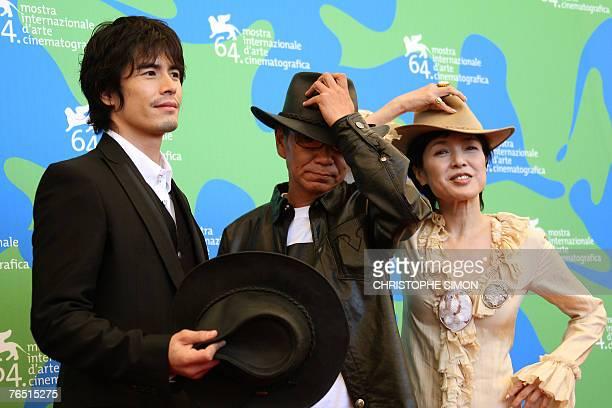 Japanese director Takashi Miike poses with Japanese actors Kaori Momoi and Kaori Momoi during a photocall of Sukiyaki Western Django during the 64th...