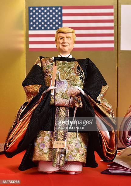 Japanese doll maker Kyugetsu displays a 'hina' doll with the likeness of US President Donald Trump at the company's showroom in Tokyo on January 26...