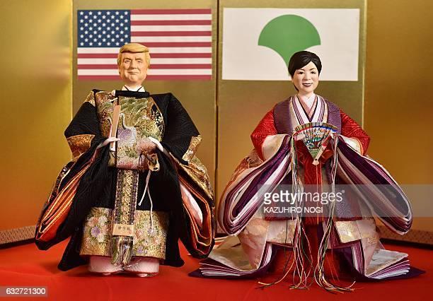 CORRECTION Japanese doll maker Kyugetsu displays sets of 'hina' dolls with likenesses of US President Donald Trump and Tokyo Governor Yuriko Koike at...