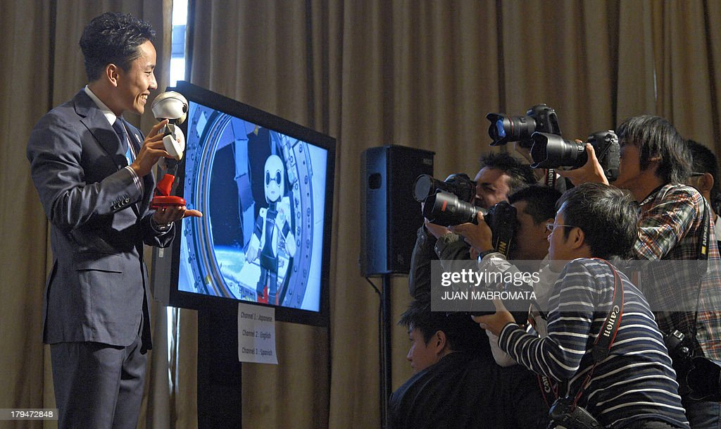 Japanese double fencing silver medallist Yuki Ota and robot Mirata are pictured during a news conference given by IOC member and President of Japanese Olympic Committee and Tokyo 2020 Tsunekazu Tak...
