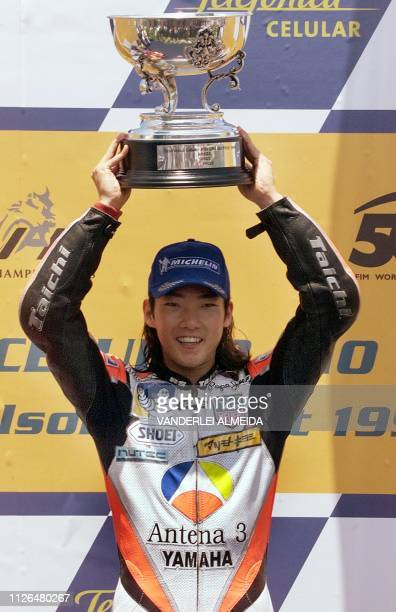 Japanese driver Abe Norick of Yamaha D'Antin celebrates his victory in the 500cc category at the Brazilian Grand Prix 24 October 1999 in Rio de...