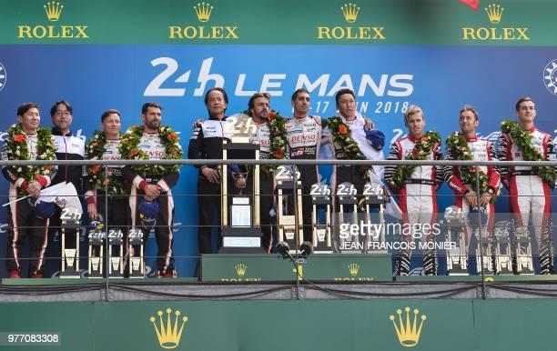 Japanese driver Kamui Kobayashi British driver Mike Conway and Argentinian driver Jose Maria Lopez Toyota's head of motorsport Shigeki Tomoyama...