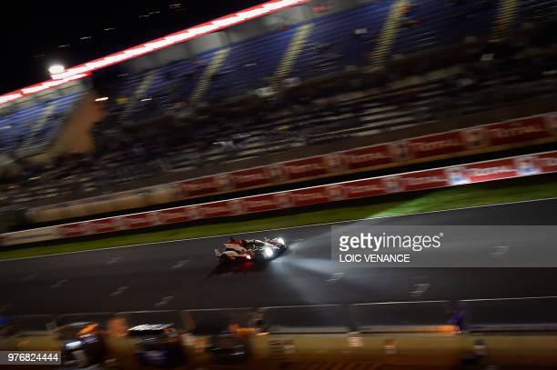 Japanese driver Kazuki Nakajima compete's in a Toyota TS050 Hybrid LMP1 during the 86th Le Mans 24hours endurance race at the Circuit de la Sarthe at...