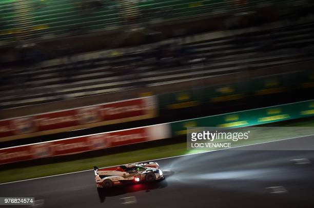 TOPSHOT Japanese driver Kazuki Nakajima compete's in a Toyota TS050 Hybrid LMP1 during the 86th Le Mans 24hours endurance race at the Circuit de la...