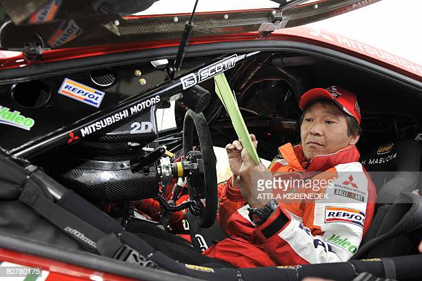 Japanese driver Masuoka Hiroshi of Repsol Mitsubishi Ralliart team arrives with his car at the Heroes square in downtown Budapest on April 19, 2008...