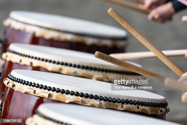 japanese drum on the winter beach for coming-of-age ceremony in japan - percussion instrument stock photos and pictures