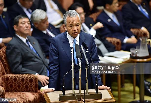 Japanese Economic Revitalization Minister Akira Amari answers a question from an opposition lawmaker at the Upper House's audit committee session at...