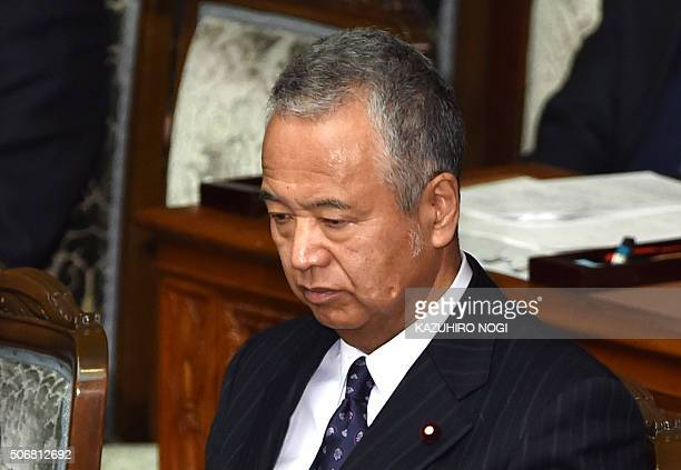 Japanese Economy and Fiscal Policy Minister Akira Amari listens to questions by the main opposition party Democratic Party of Japan during a plenary...