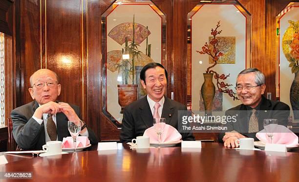 Japanese education minister Yoshiaki Takagi talks with Nobel Prize in Chemistry laureates Akira Suzuki and Eiichi Negishi a day after the award...