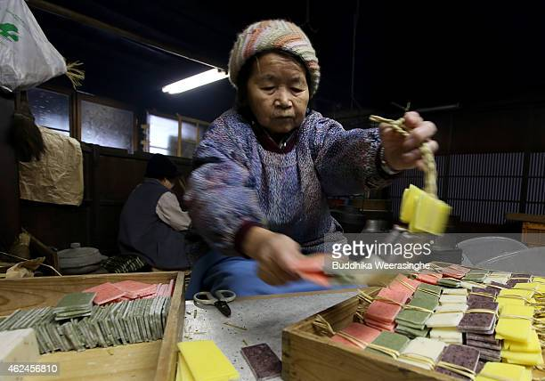 Japanese elderly woman Teruko Koboyashi makes Kakimochi a type of dried rice cake at a ricecake making house in Heisenji village on January 29 2015...