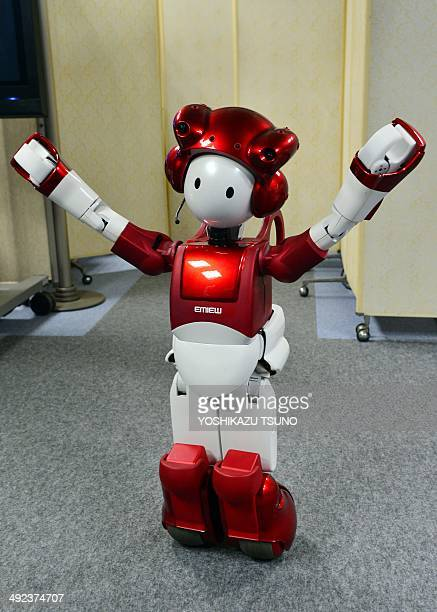 """Japanese electronics giant Hitachi's humanoid robot """"Emiew 2"""" have conversation with a company employee during a demonstration at the company's..."""