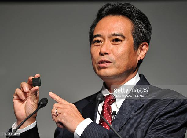 Japanese electronics giant Sony senior vice president Masashi Imamura displays the 4K XReality PRO processor for the highquality picture engine as...