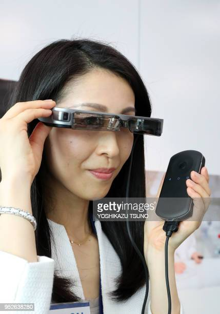 Japanese electronics maker Epson employee displays the company's new smart glasses 'Movirio BT300' at the company's headquarters in Tokyo on...