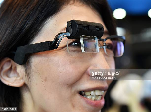 Japanese electronics maker Konica Minolta employee displays prototype model of a smart glass Wearable Communicator with a fullcolor holographic...