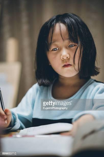 Japanese elementary school girl doing homework