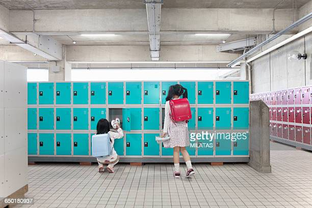 Japanese elementary school students changing wear the shoes in a locker