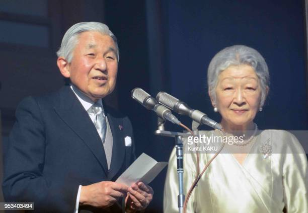 Japanese emperor Akihito 80 years old and empress Michiko hello crowd for new year day on January 2 in Tokyo Japan