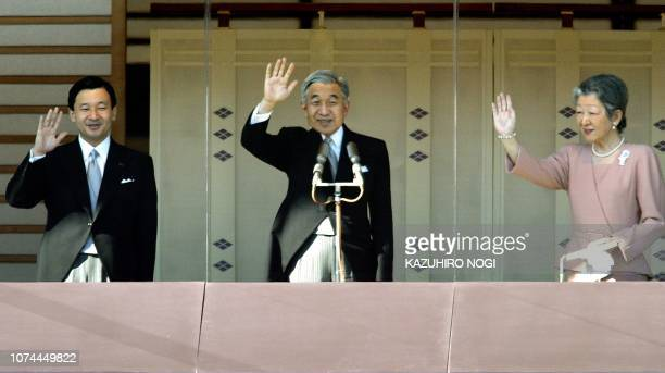Japanese Emperor Akihito accompanied by Empress Michiko and Crown Prince Naruhito wave to wellwishers in their traditional New Year greetings at the...