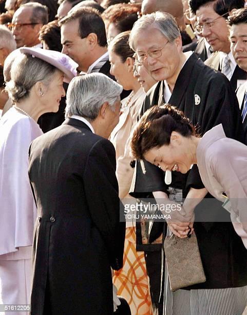 Japanese Emperor Akihito accompanied by Empress Michiko chats with Kunio Yonenaga at the annual autumn garden party at the Akasaka Palace in Tokyo 28...