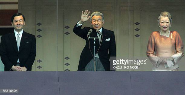 Japanese Emperor Akihito accompanied by his wife Empress Michiko and Crown Prince Naruhito waves to wellwishers from behind a bullet proof glass...