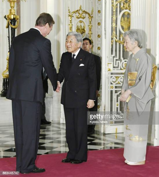 Japanese Emperor Akihito and Empress Michiko are greeted by Luxembourg's Grand Duke Henri at the Akasaka Palace state guesthouse in Tokyo on Nov 29...