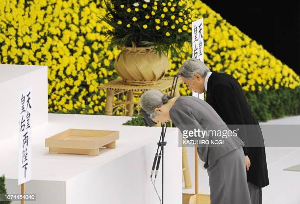 Japanese Emperor Akihito and Empress Michiko bow at the altar during the memorial ceremony for the national war dead in Tokyo on August 15 2009 Japan...