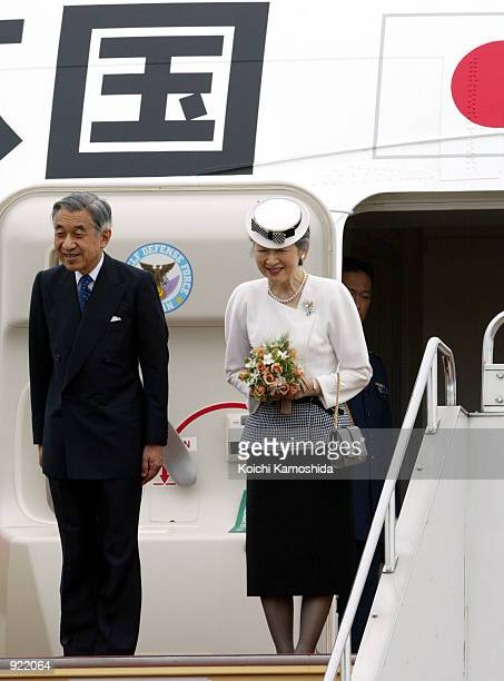 Japanese Emperor Akihito and Empress Michiko bow to admirers at Haneda airport July 6 2002 in Tokyo Japan The emperor and empress are leaving Japan...