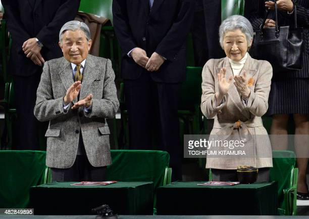 Japanese Emperor Akihito and Empress Michiko clap hands while attending the Davis Cup tennis 2014 World group quarterfinal match between Japan and...