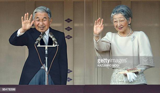 Japanese Emperor Akihito and Empress Michiko greet people from a balcony as the emperor celebrates his 76th birthday at the Imperial Palace in Tokyo...