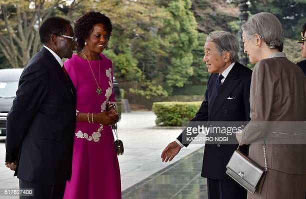 Japanese Emperor Akihito and Empress Michiko greet Zimbabwean President Robert Mugabe and his spouse Grace Mugabe upon their arrival at the Imperial...