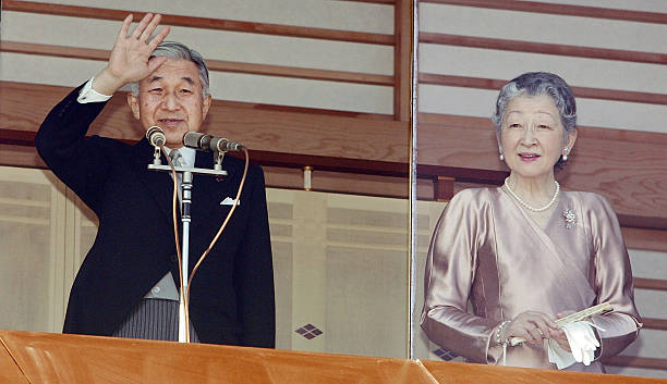 Japanese Emperor Akihito (L) and Empress Michiko greets the well-wishers  gathered to