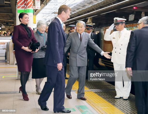 Japanese Emperor Akihito and Empress Michiko guide Luxembourg's Grand Duke Henri and his eldest daughter Princess Alexandra to a special train at...