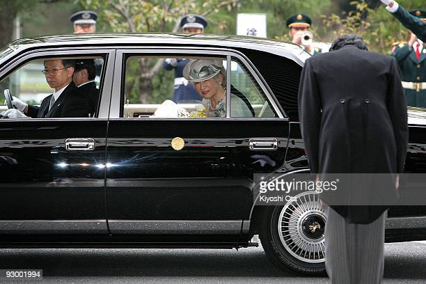 Japanese Emperor Akihito and Empress Michiko leave as Japanese Prime Minister Yukio Hatoyama bows after attending the memorial ceremony in...