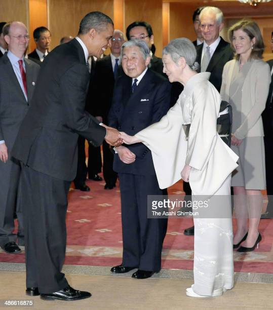 Japanese Emperor Akihito and Empress Michiko see off the US President Barack Obama as he leaves for South Korea on April 25 2014 in Tokyo Japan The...
